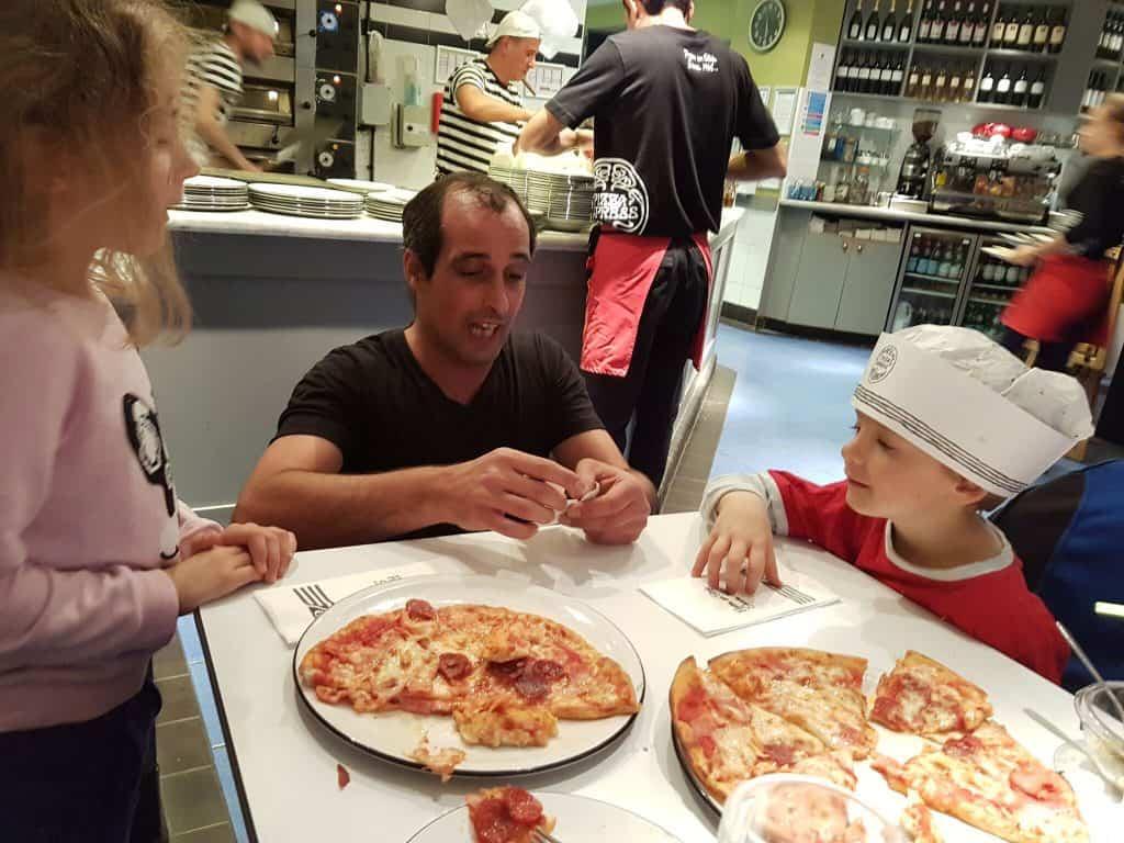 Luis teaching the children tricks