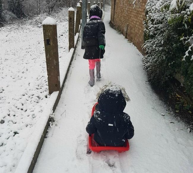 Kids pulling sledge