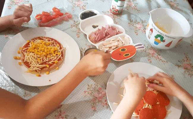 Children helping to make dinner - 10 top tips for parents of fussy eaters